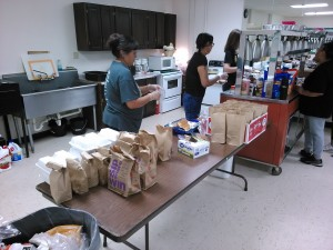 Volunteer Ministers from Dumas TX prepare lunch for the adult ministers at the Super Kids Camp VBS 2016
