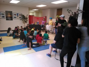 """The """"In and Out"""" ministry has story time with children at camp. Lots of prayer and hugs to go around."""